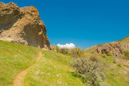 Spring landscape in mountains - path in Kara-Dag natural reserve, Crimean peninsula Stock Photo