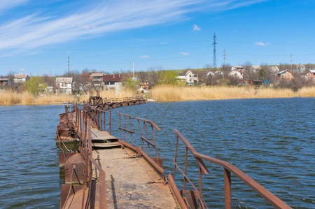 ponton: Pontoon bridge over small river to remote Ukrainian village