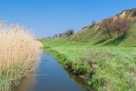 rushy: Landscape with small Ukrainian river Sura at early spring season