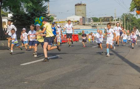 dnepr: Dnepr, Ukraine - August 24, 2016: Kids running in Vyshyvanka Run during Independence Day local activity in Dnepr, Ukraine at August 24, 2016