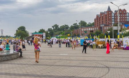 dnepr: Dnepr, Ukraine - August 24, 2016:People walking on the Dnepr river embankment during Independence Day celebrations at August 24, 2016 in Dnepr, Ukraine