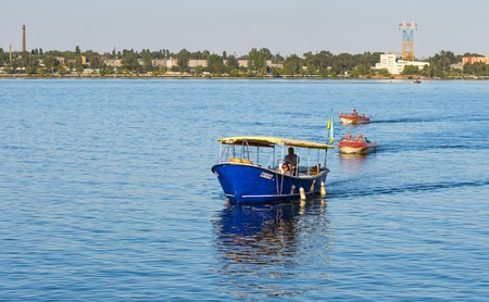 dnepr: DNEPR, UKRAINE - SEPTEMBER 10, 2016:Motor boats with passengers running between banks of Dnepr river during City Day local activity Editorial
