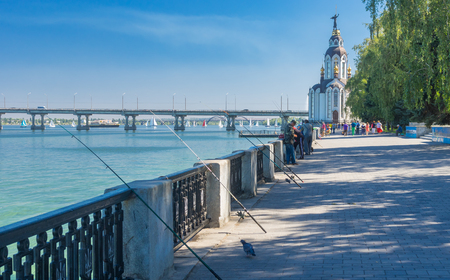 dnepr: DNEPR, UKRAINE - SEPTEMBER 10, 2016:Dnepr river embankment with fishermen and their rods during City Day local activity
