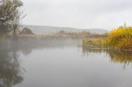Autumnal landscape with foggy Vorskla river at autumnal season in Sumskaya oblast, Ukraine