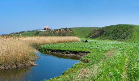 rushy: Rural landscape with small Ukrainian river Sura at early spring season.