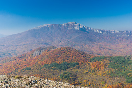 Crimean mountains at fall season - view from mountain pasture Demerdzhi to Chatyr-Dah mountainous massif.