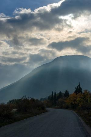 dark landscape: Dark landscape with road leading to Ayu-Dag mountain, Crimean peninsula Stock Photo