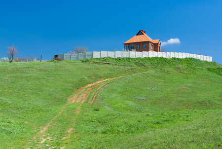 eminence: Landscape with lonely Ukrainian rural house on a hill.
