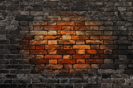 reddish: Old brick wall with oval reddish spot in the center