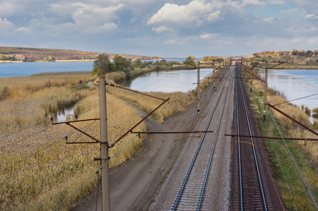 Railroad landscape at fall season in central Ukraine