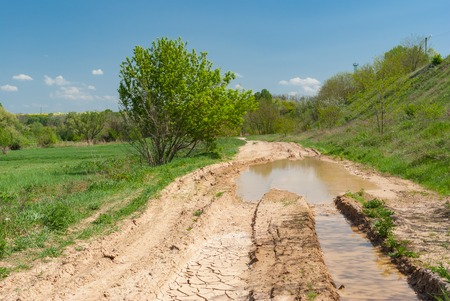 loamy: Spring landscape with clay dirty road in Ukraine