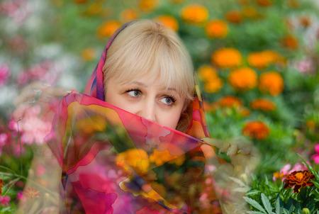 Artistic portrait of a beautiful Caucasian woman against floral background.