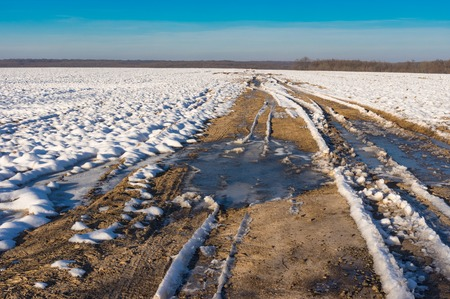 earth road: Simple winter landscape with an earth road leading into the distance, Ukraine