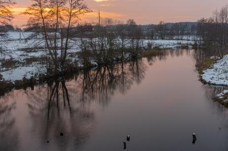 rushy: Pictorial evening landscape with Hrun river at winter sunset time, Poltavskaya oblast,  Ukraine