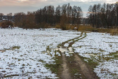 earth road: Winter rural landscape with an earth road leading to Hrun river in Sumskaya oblast, Ukraine