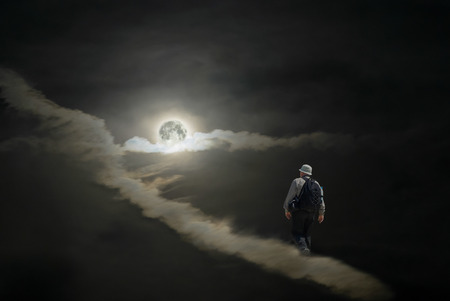Lonely tourist (sleep-walker) having a hike to the Moon on the clouds in night sky.
