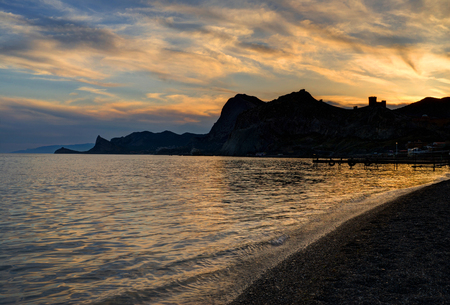 Sunset over East Crimean cost near an ancient Genoese fortress in Sudak, Crimea, Ukraine