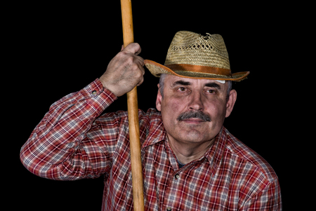 Portrait of a farmer taken in a short break of hard agricultural work.