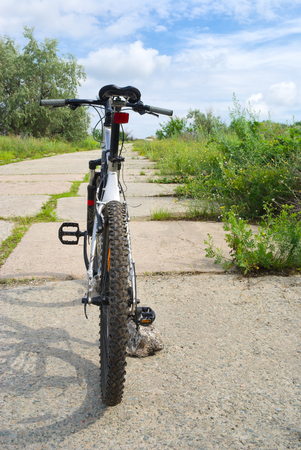 Bicycle on a roadside is waiting for the rider before an interesting journey. Stock Photo