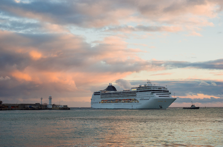 shipway: Big ship evening sailing off from Yalta port, Crimea, Ukraine. Stock Photo