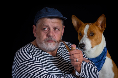 characteristic: Portrait two friends - retired sailor and his cute dog