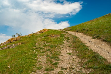 Empty hiking path to uplands in spring mountains Stock Photo