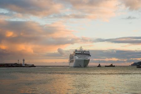 shipway: Big ship evening arrival in Yalta port, Crimea, Ukraine.