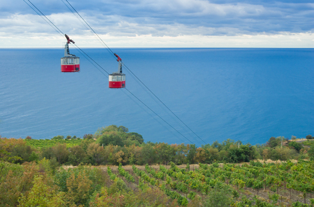 Autumnal landscape with a cable-way to the Black Sea on the Crimean resort shore Stock Photo