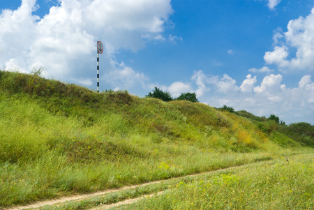 Landscape with rural road and sign no anchorage on the land. Stock Photo