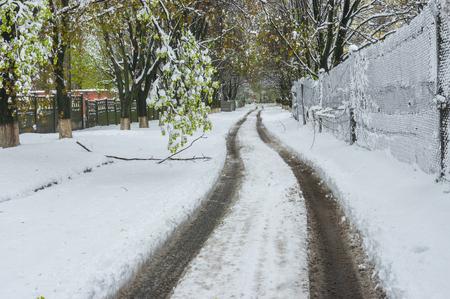 Spring landscape with road after April snow storm in Dnepr city, Ukraine