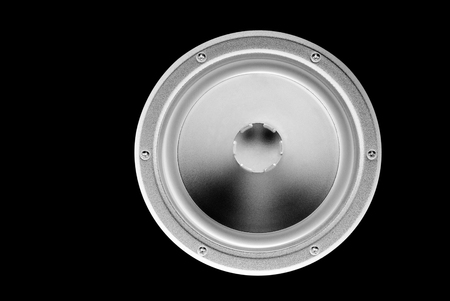 Low-frequency loudspeaker (inverted) on a black background.
