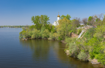 Spring landscape with an Orthodox church on a Monastyrsky island on Dnipro river, Dnipro city, Ukraine.
