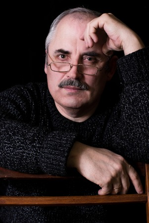 eloquent: Portrait of a Caucasian man with calm look - color version. Stock Photo
