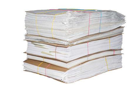 A pile of office documents prepared for archiving.