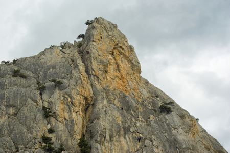 Red rock - a place for rock-climbers gathering in Crimean mountain, Ukraine. Stock Photo