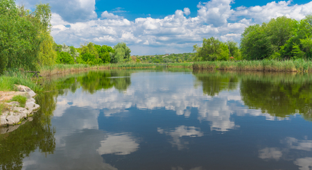 Ukrainian landscape with small river Sura near Dnipro city at spring season