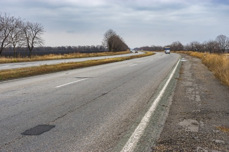Autumnal landscape with high-way in leading from Dnepr to Zaporizhia city, Ukraine