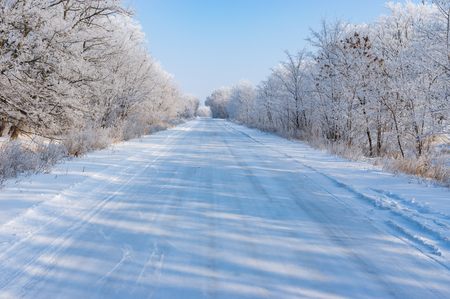 Winter landscape with slippery country road in Dnepropetrovskaya oblast, Ukraine Stock Photo