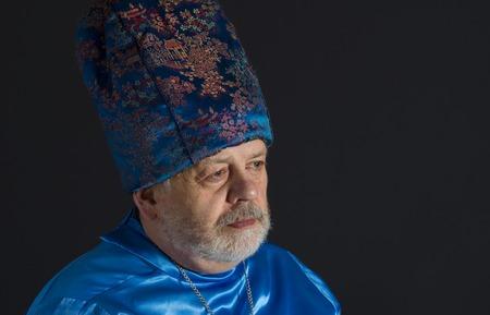 dictatorial: Portrait of senior man in blue oriental clothes