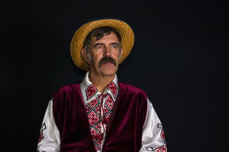 Low key portrait of mature Ukrainian country-man in traditional clothes