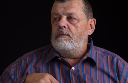 dictatorial: Nice portrait of a thoughtful senior man in striped shirt