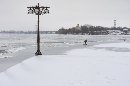Winter landscape on a Dnipro river embankment in center of the same name  city, Ukraine