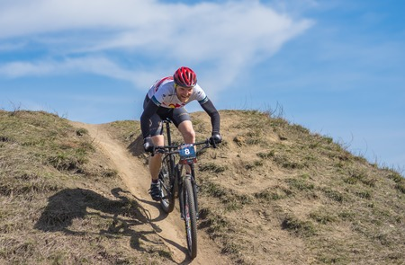 DNIPRO, DP UKRAINE - APRIL 01, 2018: Participant cycling down over hill   during first amateurs spring race Kodaki of a local bicycle club in Dnipro, at April 1, 2018