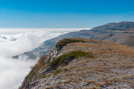 Autumnal landscape with Babuhan Yaila natural reserve with blanket of fog arisen from the Black Sea  in Crimean peninsula