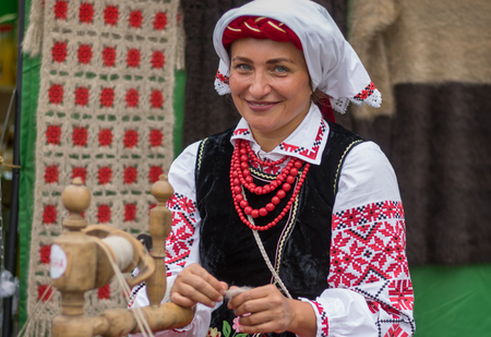 DNIPRO, UKRAINE - SEPTEMBER 09, 2018: Portrait of beautiful mature woman wearing Ukrainian national costume with embroidered shirt Vyshyvanka during City Day local activity Editorial