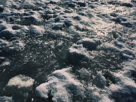 Rough iced surface on a winter river Фото со стока