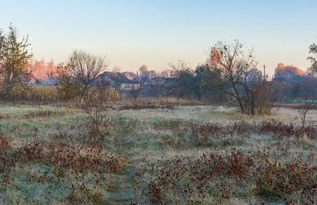 Early moring landscape with pedestrian path through autumnal meadow in Pidstavky village, Sumskaya oblast, Ukraine Reklamní fotografie
