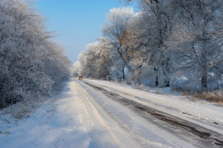Winter landscape with slippery country road in Ukraine 스톡 콘텐츠
