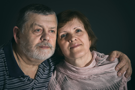 Indoor portrait of Caucasian senior man and woman in low key