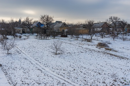 Winter landscape with peasant houses and their backyards in Vasilyvka town, Zaporizhia Oblast, Ukraine